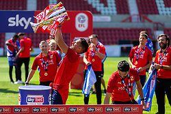 (Free to use courtesy of Sky Bet) Mathieu Baudry lifts the trophy as Swindon Town gather at The County Ground to celebrate becoming Sky Bet League Two Champions, with a socially distanced trophy lift, after the curtailment of the regular season due to the Covid-19 pandemic - Rogan/JMP - 26/06/2020 - The County Ground - Swindon, England - Sky Bet League 2.