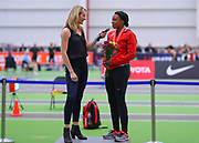 Keturah Orji (right) receives is interviewed by Carrie Tollefson after winning the triple jump during the USA Indoor Track and Field Championships in Staten Island, NY, Sunday, Feb 24, 2019. (Rich Graessle/Image of Sport)