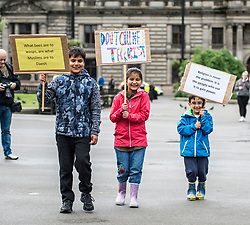 Muslims Stand Against Terrorism held a rally in George Square, Glasgow in condemnation of the terror attacks in Manchester and London. Protesters included Umar Akbar (8) and Fatim Akbar (7) and 5 year old Hamid Faisal.<br /> <br /> © Dave Johnston/ EEm