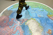 A Canadian military walk over a stamped map depicting the North Pole in Yellowknife airport prior to operation Nunalivut 2012.