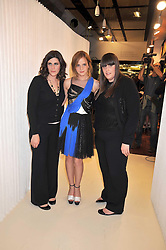Left to right, LAURA MULLEAVY, EMMA WATSON and KATE MULLEAVY at a dinner in honour of design label Rodarte held at the Fifth Floor Restaurant, Harvey Nichols, Knightsbridge, London on 3rd June 2009.