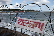 The barbed wire fences on the cost close to the DMZ Demilitarized zone / Daejin, South Korea, Republic of Korea, KOR, 08 October 2009.