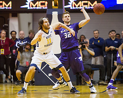 Feb 11, 2017; Morgantown, WV, USA; West Virginia Mountaineers forward Nathan Adrian (11) boxes out Kansas State Wildcats forward Dean Wade (32) to receive a pass during the first half at WVU Coliseum. Mandatory Credit: Ben Queen-USA TODAY Sports