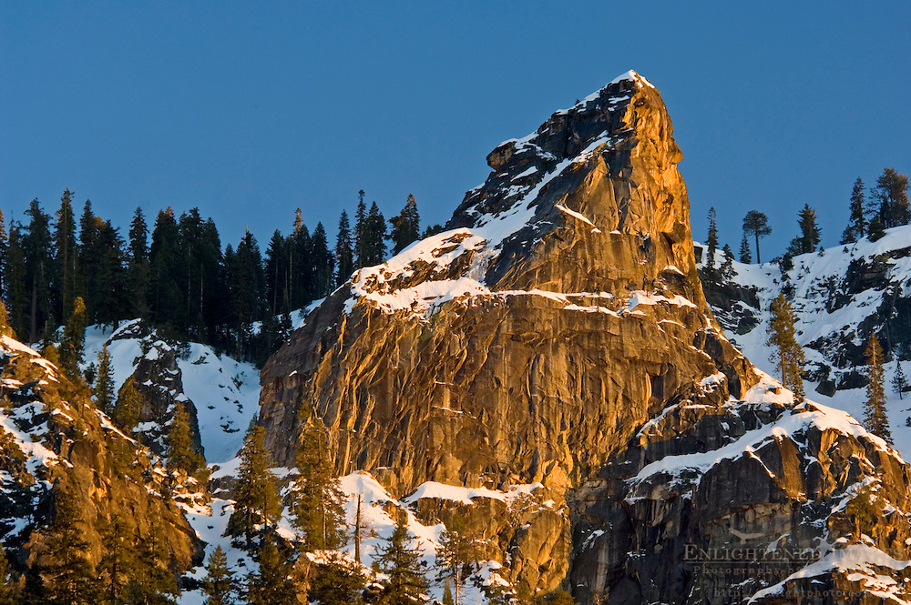 Golden Sunset light on granite rock mountain peak above Yosemite Valley, Yosemite National Park, California