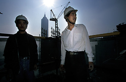 CHINA SHANGHAI PUDONG MAY99 - Two Chinese construction workers take a break atop a Pudong highrise.  Pudong has experienced a dramatic rise in construction projects, although vacancy rates stand at nearly 60% and a bust-cycle is imminent.  ..jre/Photo by Jiri Rezac..© Jiri Rezac 1999..Contact: +44 (0) 7050 110 417.Mobile:  +44 (0) 7801 337 683.Office:  +44 (0) 20 8968 9635..Email:   jiri@jirirezac.com.Web:     www.jirirezac.com..© All images Jiri Rezac 2004 - All rights reserved.