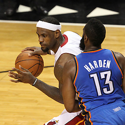 Jun 19, 2012; Miami, FL, USA; Miami Heat small forward LeBron James (6) drives against Oklahoma City Thunder guard James Harden (13) during the second quarter in game four in the 2012 NBA Finals at the American Airlines Arena. Mandatory Credit: Derick E. Hingle-US PRESSWIRE