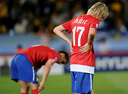 A dejected Milos Krasic (Serbia) reflects during the 2010 FIFA World Cup South Africa Group D match between Serbia and Ghana at Loftus Versfeld Stadium on June 13, 2010 in Pretoria, South Africa.