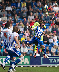 COLCHESTER, ENGLAND - Saturday, April 24, 2010: Tranmere Rovers' Bas Savage out jumps Colchester United's Matt Heath during the Football League One match at the Western Community Stadium. (Photo by Gareth Davies/Propaganda)