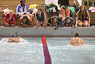 Teammates cheer on Washington's Jackie Hughes (lane 4) and Kennedy's Amanda Jacobsen (lane 3) during the 100 yard breaststroke event during the Kennedy at Washington meet at Washington High School in Cedar Rapids on Tuesday evening, October 2, 2012. Hughes placed first with a time of 1:12.07 and Jacobsen second with a time of 1:15.90.