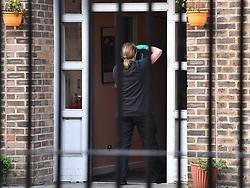 © Licensed to London News Pictures. 03/02/2020. London, UK. A police officer collecting evidence with a camera at a bail hostel in Steatham, South London used by Sudesh Amman, near the scene on Streatham High Road where a man was shot dead by police yesterday after a number of people were stabbed. Metropolitan Police declared the incident terrorist-related. Photo credit: Ben Cawthra/LNP