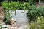 Outdoor shower area planted with Westringia rosmarinifolia, Thymus cv and Nerium oleander.<br /> <br /> Sophie and Kent Cooper's garden, Montecito, CA<br /> <br /> photography &copy; Andrea Jones/Garden Exposures Photo Library