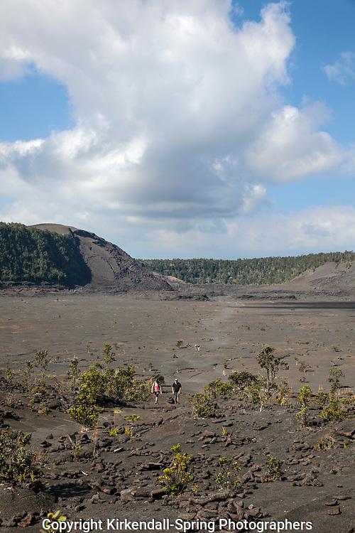HI00370-00...HAWAI'I - Hikers crossing the Kilauea Iki Crater in Hawai'i Volcanoes National Park.