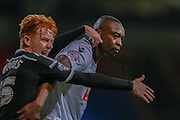 Brentford midfielder Ryan Woods  battles with Bolton Wanderers forward Shola Ameobi  during the Sky Bet Championship match between Bolton Wanderers and Brentford at the Macron Stadium, Bolton, England on 30 November 2015. Photo by Simon Davies.