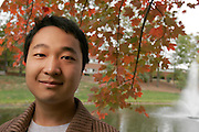 Kate Robertson.10/20/05.Portrait of Kangkang Wang at a Ohio University's Clippinger Lab classroom. Seventeen-year old Wang is a PhD student from China studying Physics. Until he came to the United States, Wang seldom ventured outside of his home village. Aside from his studies which occupies the majority of his time, he enjoys writing calligraphy and exercises at the Ping center.