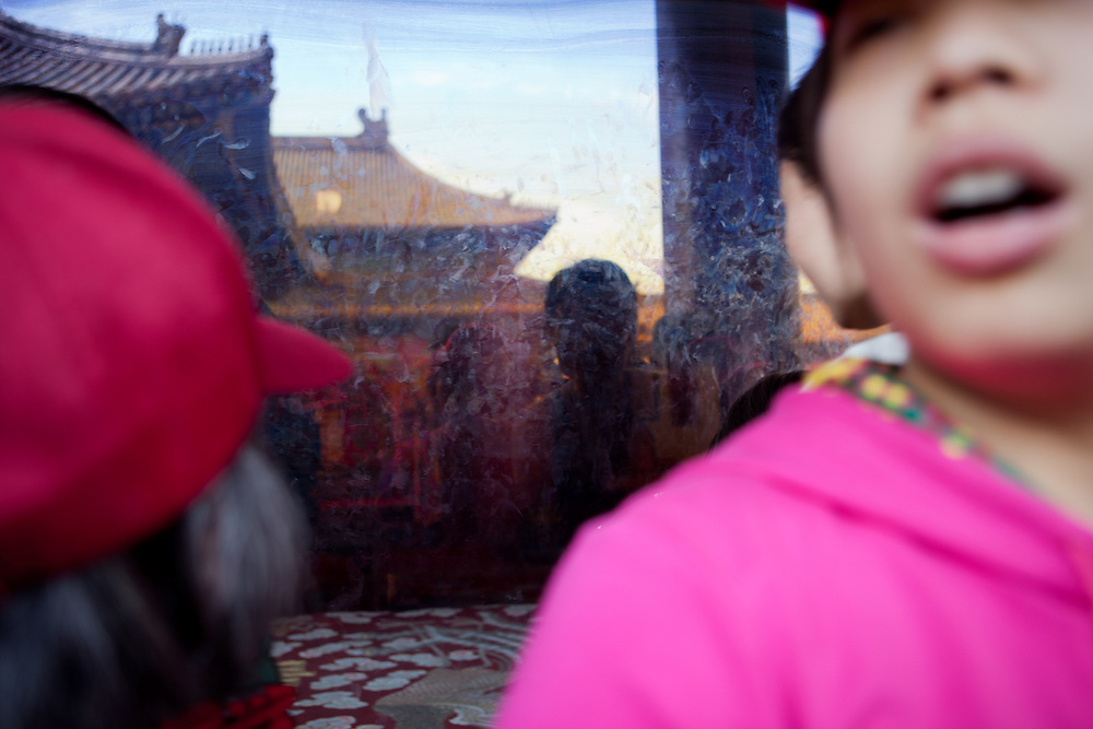"Reflection in a glass window protecting one temple at ""The Forbidden City"" which was the Chinese imperial palace from the Ming Dynasty to the end of the Qing Dynasty. It is located in the middle of Beijing, China. Beijing is the capital of the People's Republic of China and one of the most populous cities in the world with a population of 19,612,368 as of 2010."