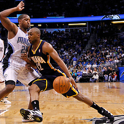 March 11, 2012; Orlando, FL, USA; Indiana Pacers guard A.J. Price (12) drives past Orlando Magic point guard Chris Duhon (25) during the fourth quarter of a game at  Amway Center. The Magic defeated the Pacers 107-94.  Mandatory Credit: Derick E. Hingle-US PRESSWIRE