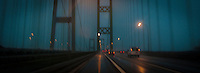 panoramic image while driving across the northbound span of the Tacoma Narrows Bridge in the rain at night, Tacoma, WA, USA