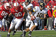 University of Missouri quarterback Chase Daniel (10) is pressured out of the pocket by Nebraska defenders Adam Carriker (90) and Barry Turner (99) in the first half at Memorial Stadium in Lincoln, Nebraska, November 4, 2006.  The Huskers beat the Tigers 34-20.<br />
