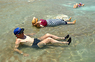 Israeli elderls enjoy the benefits of  rich salt waters as they float in the Dead sea in the lowest point of Israel and the World 500 meters under sea level Tuesday July 10, 2001. Despite the 11 months of violence Israelis and Palestinians take a break to enjoy the mediterrenean beaches and the Dead Sea, where under growing tensions and in the case of Gaza under closure people try to  make the best of their summer and carry on a normal life.