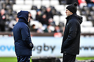 Cardiff Blues' Head Coach Danny Wilson and Ospreys' Head Coach Steve Tandy chat during the pre match warm up<br /> <br /> Photographer Craig Thomas/Replay Images<br /> <br /> Guinness PRO14 Round 13 - Ospreys v Cardiff Blues - Saturday 6th January 2018 - Liberty Stadium - Swansea<br /> <br /> World Copyright &copy; Replay Images . All rights reserved. info@replayimages.co.uk - http://replayimages.co.uk