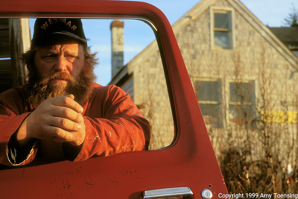 MONHEGAN ISLAND, MAINE - NOVEMBER 22: Lobsterman Mattie Thomson stands by his truck, November 22, 1999 Monhegan Island, Maine. Monhegan Island, home to lobstermen and painters and a popular destination for tourists is twelve miles off the coast of Maine. Ringed by high, dark cliffs, its interior a mix of meadows, marsh and spruce groves, Monhegan is one of just 14 true island communities left off the coast of Maine. The island has a 65 permanent, year-round residents and the population grows to around 200 in the summer, with day-trippers adding several hundred more. (Photo by Amy Toensing) _________________________________________<br />