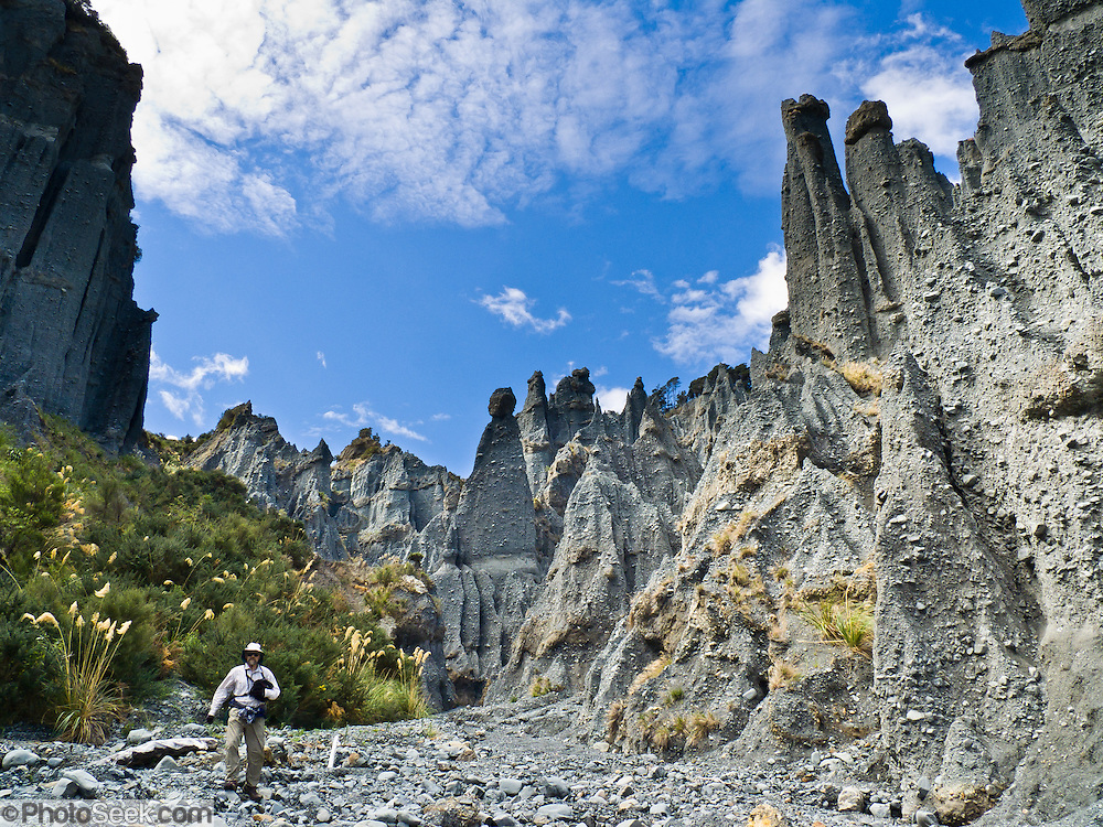 "The Putangirua Pinnacles were featured as the Dimholt Road in the ""Lord of the Rings: The Return of the King"" motion picture. When ocean levels were much higher 7 to 9 million years ago, the Aorangi Ranges were an island which deposited large alluvial fans at the seashore. Conglomerate rock formed in layers. Erosion over the past several thousand years created a badlands of earth pillars (or hoodoos) at the head of this valley in the Aorangi Ranges."