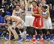 Lake Central celebrates their 48-41 win over E.C. Central in the 4A basketball sectionals Wednesday at Lowell High School.