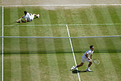 04.07.2014, All England Lawn Tennis Club, London, ENG, ATP Tour, Wimbledon, im Bild Grigor Dimitrov (BUL) and Novak Djokovic (SRB) pick themselves up after ending up on the floor during the Gentlemen's Singles Semi-Final match on day eleven // during the Wimbledon Championships at the All England Lawn Tennis Club in London, Great Britain on 2014/07/04. EXPA Pictures © 2014, PhotoCredit: EXPA/ Propagandaphoto/ David Rawcliffe<br /> <br /> *****ATTENTION - OUT of ENG, GBR*****