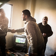 Syrian refugees meet in one of their appartments, on december 22nd 2013 in Irbid.