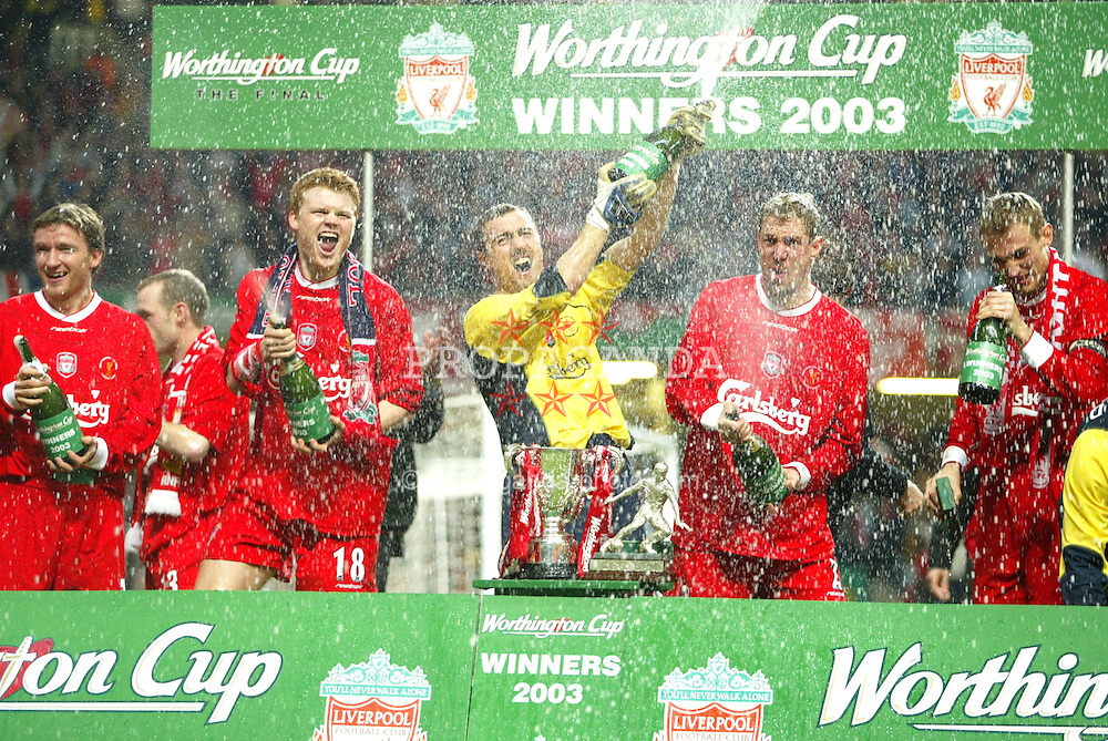 CARDIFF, WALES - Sunday, March 2, 2003: Liverpool's man-of-the-match, goalkeeper Jerzy Dudek, celebrates with team-mates John Arne Riise (l) and Stephane Henchoz after beating Manchester United 2-0 at the Football League Cup Final at the Millennium Stadium. (Pic by David Rawcliffe/Propaganda)