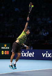 Jean-Julien Rojer serves during his doubles match with team mate Horia Tecau against Pierre Hugues Herbert and Nicolas Mahut during day one of the NITTO ATP World Tour Finals at the O2 Arena, London.