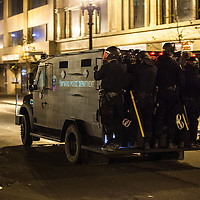 OAKLAND, CA - NOVEMBER 14, 2011: Hayward Police officers make their way towards Broadway street in order to form a line and prevent protesters from spreading throughout the city. Officers from multiple agencies were called in to support the OPD.