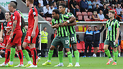 Andy Barcham is held back by Lyle Taylor during the Sky Bet League 2 match between Crawley Town and AFC Wimbledon at the Checkatrade.com Stadium, Crawley, England on 15 August 2015. Photo by Michael Hulf.