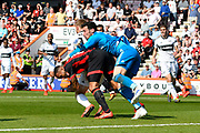 Callum Wilson (13) of AFC Bournemouth is clattered by Sergio Rico (25) of Fulham and Tim Ream (13) of Fulham during the Premier League match between Bournemouth and Fulham at the Vitality Stadium, Bournemouth, England on 20 April 2019.