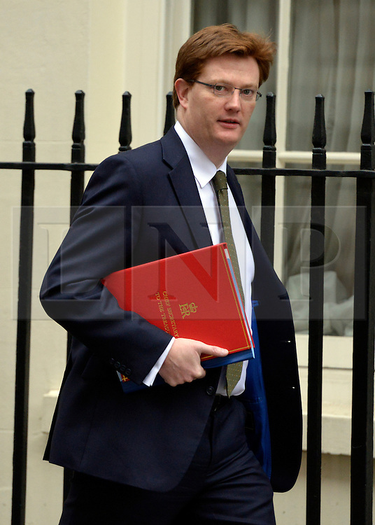 © Licensed to London News Pictures. 20/03/2013. Westminster, UK. Danny Alexander,  Liberal Democrat MP, Chief Secretary to the Treasury..Chancellor Of The Exchequer George Osborne poses for photographers whilst holding his red ministerial box outside 11 Downing Street In London, before presenting his annual budget to parliament today 19th March 2013. Photo credit : Stephen Simpson/LNP