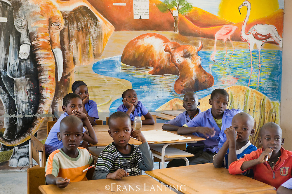 Students and wildlife mural inside village school, Puros Conservancy, Damaraland, Namibia