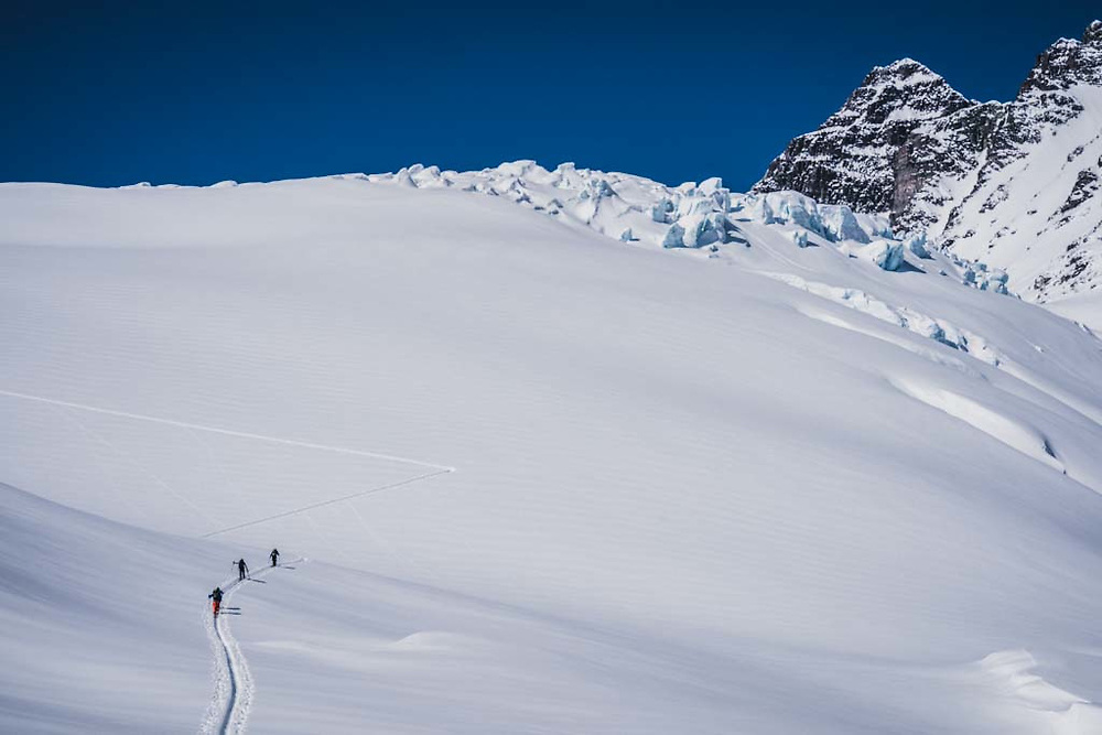 Joe Morabito, Erme Catino, and Simon Thomson out for a walk on the Loft Peak Glacier, Howson Range, British Columbia.