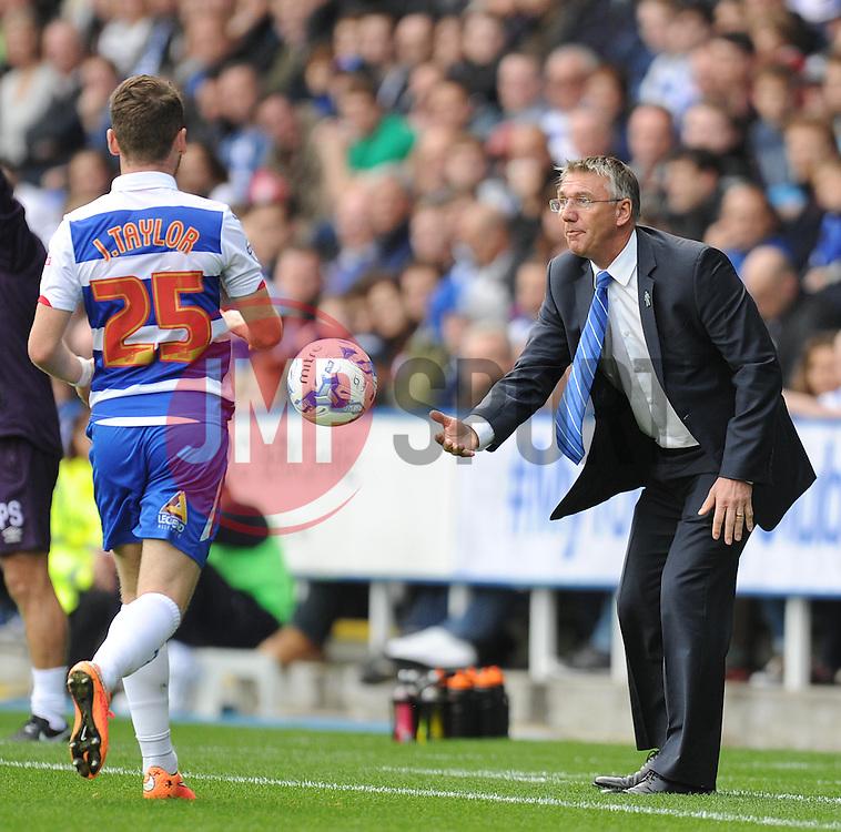 Reading Manager, Nigel Adkins passes Reading's Jake Taylor the ball. - Photo mandatory by-line: Alex James/JMP - Mobile: 07966 386802 - 18/10/2014 - SPORT - Football - Reading - Madejski Stadium - Reading v Derby County - Sky Bet Championship