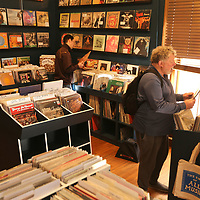 Customers shop for albums at The End of All Music at their new location on the square in Oxford.