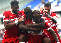 Britt Assombalonga of Middlesbrough (2nd L) celebrates after scoring his sides second goal with Adama Traore - Mandatory by-line: Jack Phillips/JMP - 09/09/2017 - FOOTBALL - Macron Stadium - Bolton, England - Bolton Wanderers v Middlesbrough - English Football League Championship