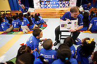 BBVA executives participate in a NBA All-Star game weekend event, Feb. 14, 2013 in Houston, TX at Eliot Elementary school.