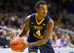 Dec 17, 2015; Charleston, WV, USA; West Virginia Mountaineers guard Daxter Miles Jr. (4) looks to pass during the first half against the Marshall Thundering Herd at the Charleston Civic Center . Mandatory Credit: Ben Queen-USA TODAY Sports