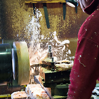 Venice Wood carver  prepares a wooden mould to be used by a glass blower. The use of a wooden mould is a very primitive technique to create glass objects and has to be performed by the skilled hands of real artisans, resulting in a high-quality and well-made vase...HOW TO BUY THIS PICTURE: please contact us via e-mail at sales@xianpix.com or call our offices in Milan at (+39) 02 400 47313 or London   +44 (0)207 1939846 for prices and terms of copyright..