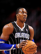 Mar. 13, 2011; Phoenix, AZ, USA; Orlando Magic center Dwight Howard (12) reacts on the court against the Phoenix Suns at the US Airways Center. The Magic defeated the Suns 111-88. Mandatory Credit: Jennifer Stewart-US PRESSWIRE