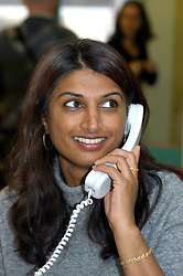 Housing Officer on telephone in office; Bradford; UK