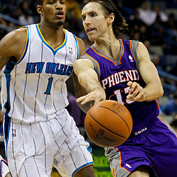 February 2, 2012; New Orleans, LA, USA; Phoenix Suns point guard Steve Nash (13) passes the ball as New Orleans Hornets small forward Trevor Ariza (1) defends during the second half of a game at the New Orleans Arena. The Suns defeated the Hornets 120-103.  Mandatory Credit: Derick E. Hingle-US PRESSWIRE
