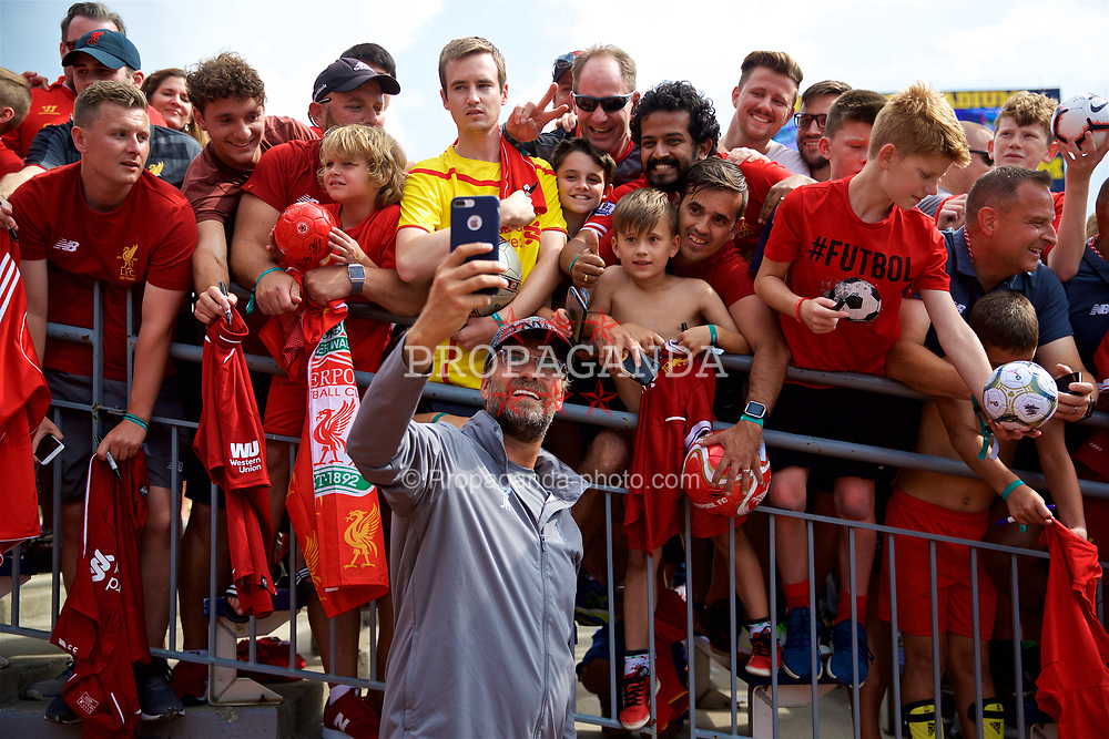 ANN ARBOR, USA - Friday, July 27, 2018: Liverpool's manager Jürgen Klopp takes a selfie with a supporter's iPhone after a training session ahead of the preseason International Champions Cup match between Manchester United FC and Liverpool FC at the Michigan Stadium. (Pic by David Rawcliffe/Propaganda)