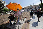 Athens, Greece. Opening days of documenta14.<br /> Syntagma Square. Performance Check Point Prosfygika by Ibrahim Mahama.<br /> A lottery seller doesn't want to move out.