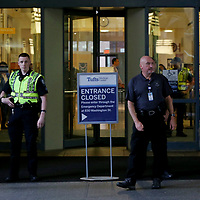 (Boston, MA - 7/13/17) Security officials keep watch outside Tufts Medical Center after nurses were locked out following a one-day strike, Thursday, July 13, 2017. Staff photo by Angela Rowlings.
