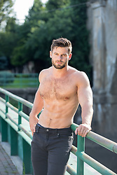 good looking shirtless man outdoors